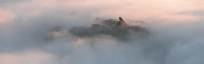 Helm Crag summit above the clouds